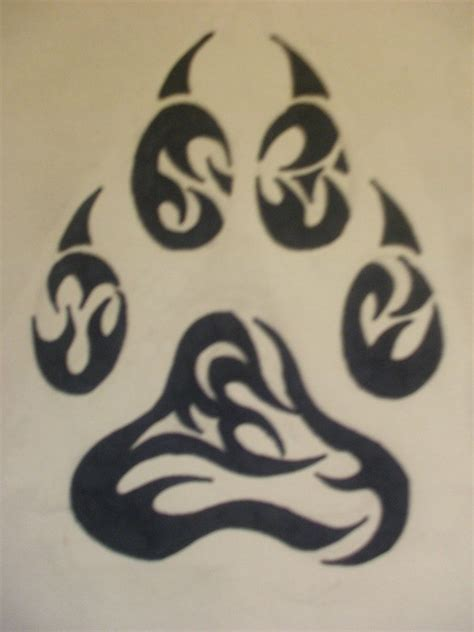 tribal paw print tattoo tribal wolf paw by amitrixwolf on deviantart