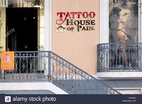 the parlour tattoo shop sign stock photos shop sign stock