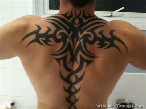 back tattoo man on ledge 7 tatuajes de espalda para hombres los mejores tatuajes