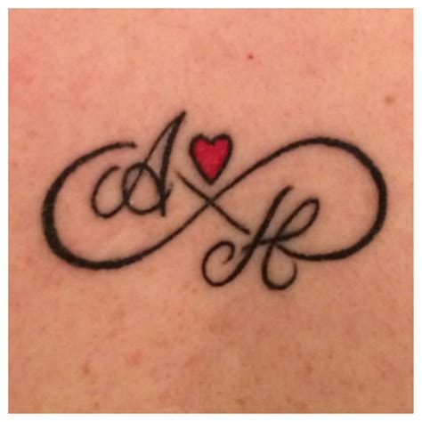 infinity tattoo with j 46 heart infinity symbol tattoos