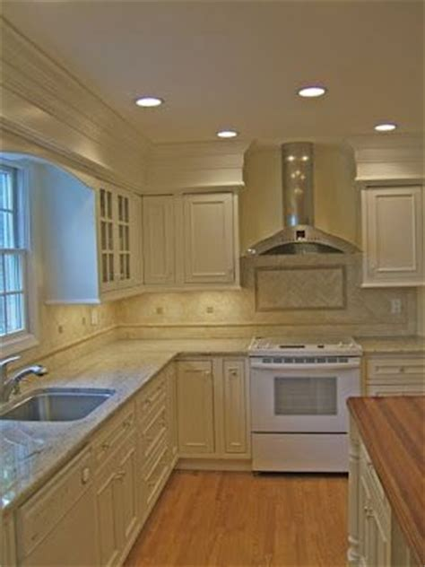 hide soffit above kitchen cabinets by adding crown molding crown molding over soffits kitchen pinterest