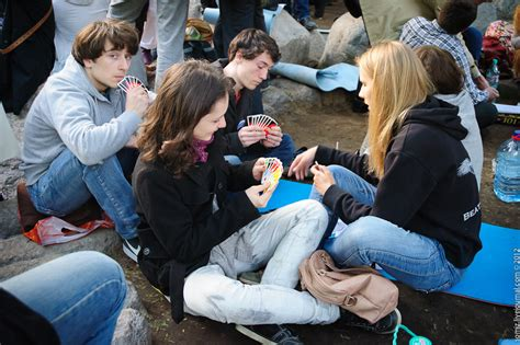 what is the meaning of young people who have a grey streaks young people playing cards after