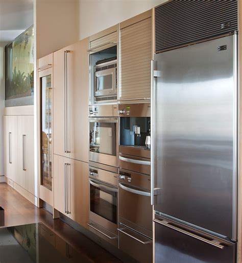 microwave mounted under small cabinet next to fridge why you should flush mount a wall oven reviews how tos