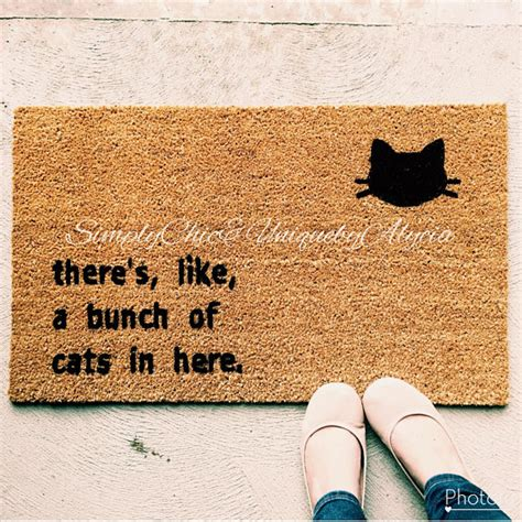theres like a bunch of dogs in here mat there s like a bunch of cats in here doormat