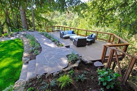 sloped backyard deck ideas deck over hillside slope from http www mladesigngroup com projects outdoors