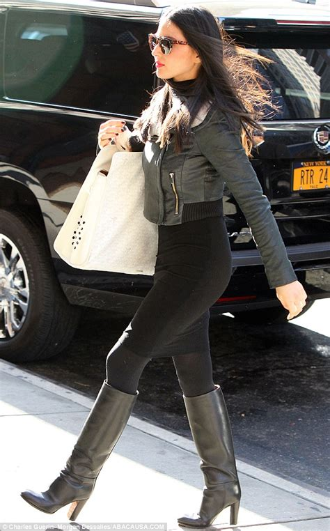 olivia munn boots olivia munn carries dog chance while tottering in animal