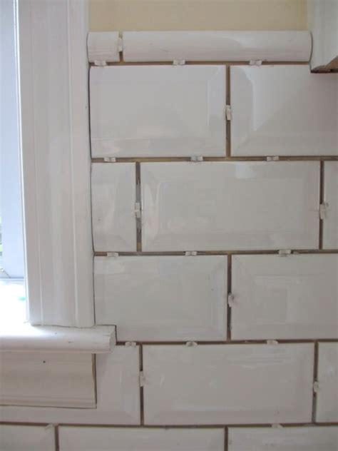 beveled subway tile kitchen 25 best ideas about beveled subway tile on glass cabinets classic white kitchen