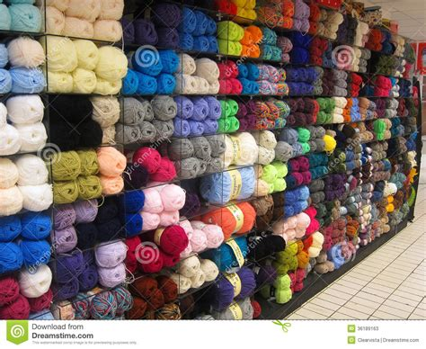 knit shops balls of wool or yarn in a store editorial stock photo