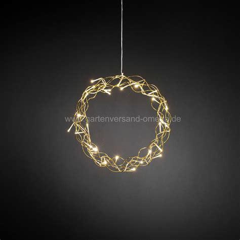 Beleuchtete Fensterdekoration Weihnachten by Led Metallsilhouette Kranz Gold Leuchtende Fensterdeko
