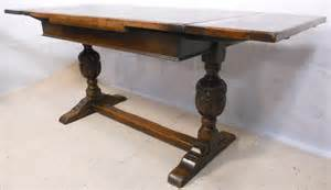 jacobean style carved oak drawerleaf refectory dining table sold
