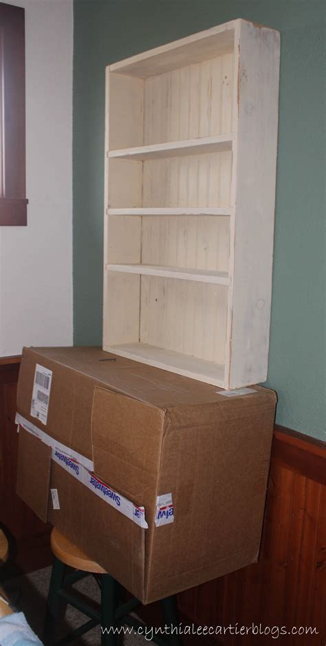 how to hang cabinets by yourself diy window wall cabinet cynthia cartier