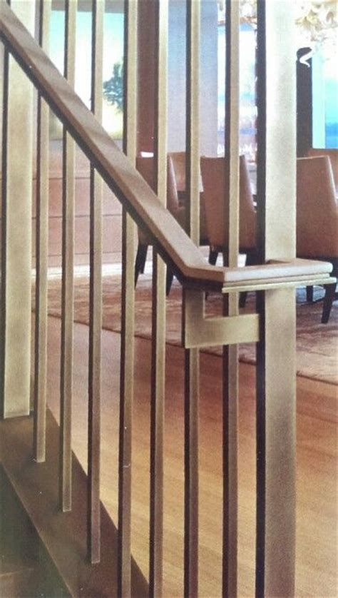 brass and flat bar stair screen and handrail with
