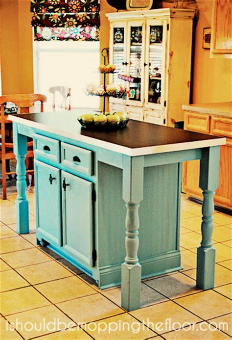 i redid our kitchen island to add a larger counter