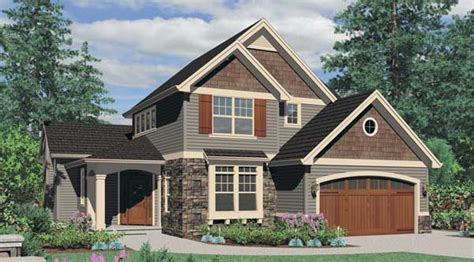 Wood work on the carriage style garage doors that match the front door