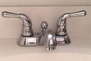 Kitchen Sink Faucet Removal Bathroom Fixtures How To Remove The Handles From This Faucet Home Improvement Stack Exchange