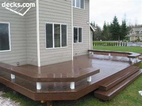 deck with built in bench with extra wide deck steps and built in benches instead of