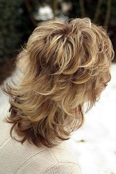 feathered haircut all around head medium length medium hairstyles for mature women mid length layered