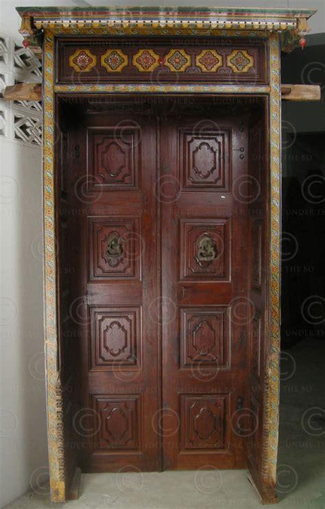 colonial door   partly painted teakwood  century
