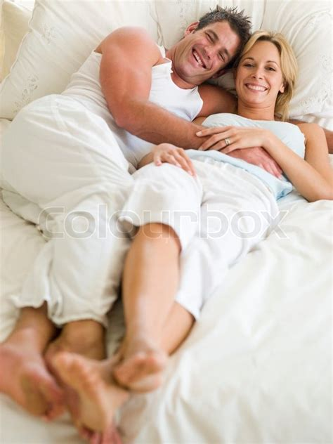 laying on my bed man and women laying on a bed stock photo colourbox