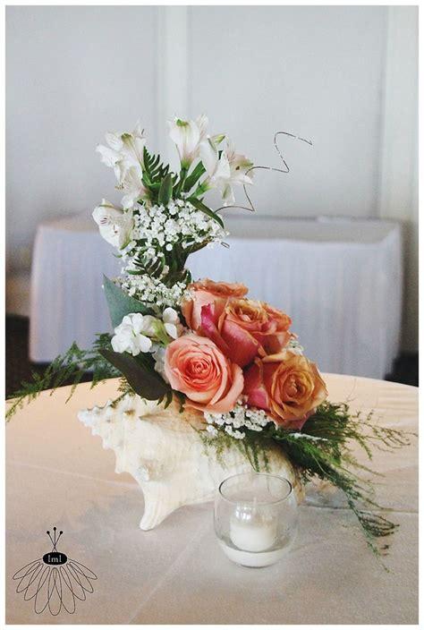 diy floral arrangement with little miss lovely conch shell flower arrangement centerpiece little miss