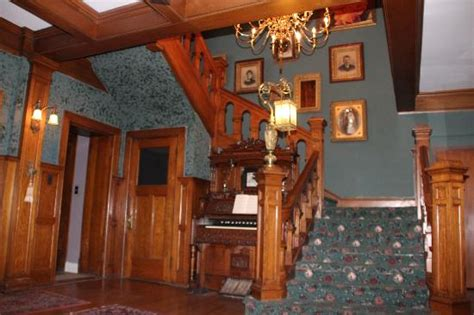 view of staircase in foyer from library picture of