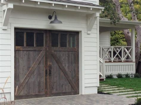 light above garage door porch roofing and exterior lighting ideas newlywoodwards