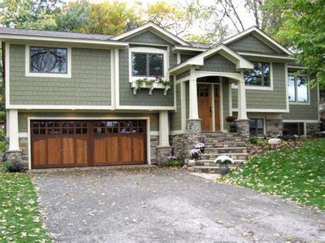 green split level home   car garage hgtv
