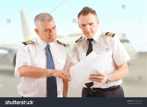 Airline Pilot Background Check Airline Pilots Wearing Epaulettes Checking Stock Photo 129735278