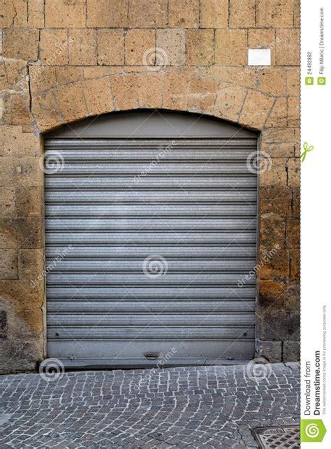 Metal Roll Up Doors by Metal Gray Roll Up Door Stock Photography Image 24492882