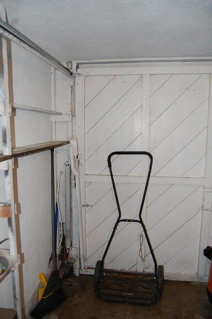 How can I replace a tilt up garage door, with near zero