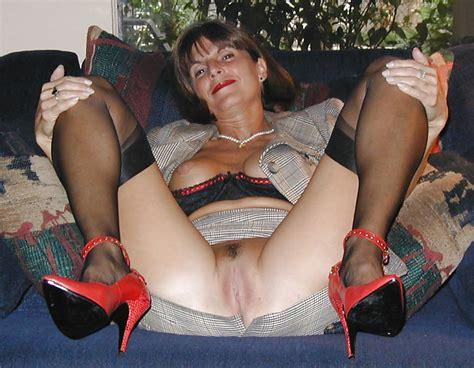 Mature Milf In Black Silk Stocking And Red Stilettos