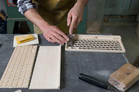 designboom universal expert handfinished wooden keyboard features universal bluetooth