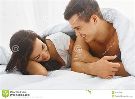 how to please a man sexually in bed portrait of man and woman in bed stock photo image 61074968