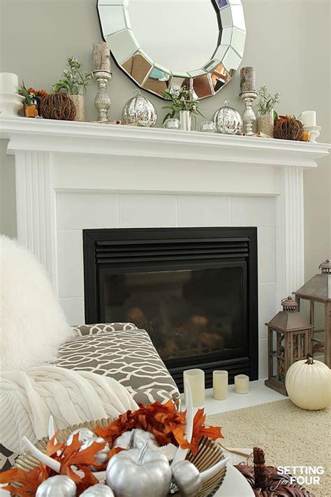 simple elegant home decor fall mantel decor using fall flowers and foliage setting