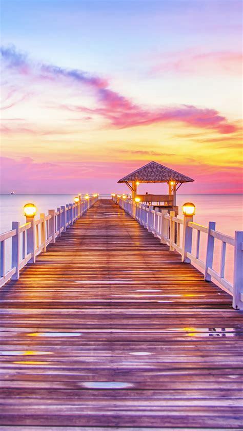 sunset pier iphone wallpaper