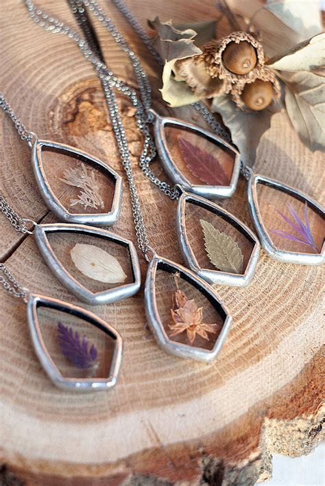 artist captures natures beauty  pressed glass jewelry