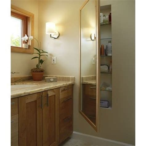length mirror on a recessed medicine cabinet
