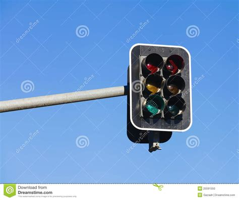 blue lights on traffic lights traffic light on blue sky background stock photo image