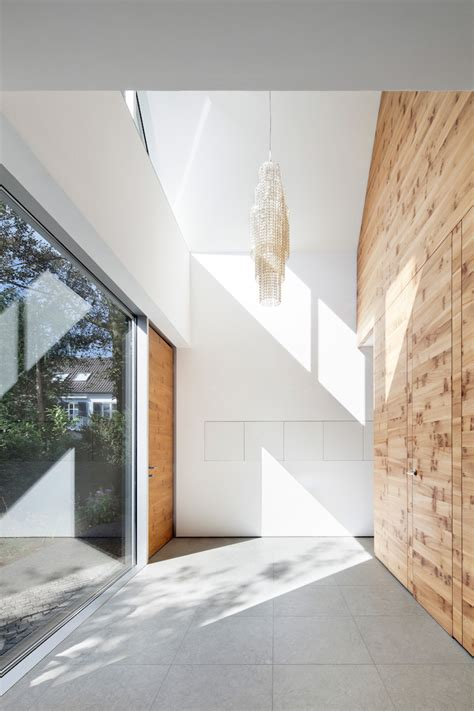 natural interior design wooden element in the middle dividing the rooms of the house