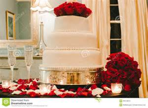 white wedding cake with red roses stock photos image 38416873