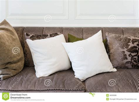white pillows for couch white pillows on brown sofa stock photo image of