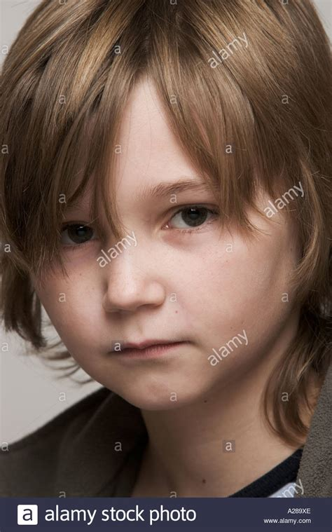 10 year old boy with long hair portrait of 11 year old boy with long hair stock photo