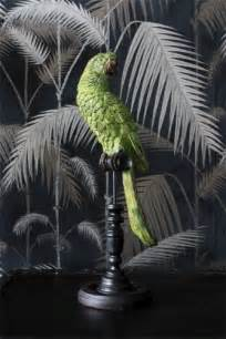 green tropical parrot on a perch decorative accents