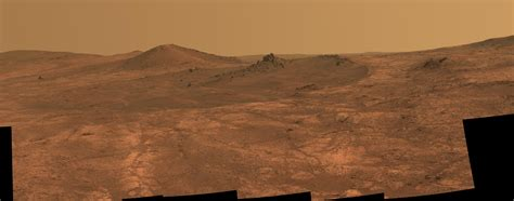 spirit mars rover cameras opportunity rover sees rock spire in mars crater photo