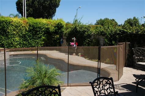 pros and cons of pool fences vs pool covers pool covers vs pool fence the pros and cons of pool