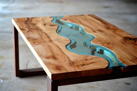 river coffee table wood by hilla shamia molten aluminium and charred