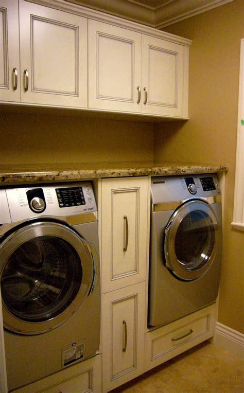 under counter washer dryer laundry room traditional with