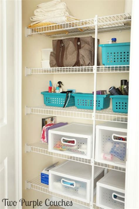 bathroom closet storage ideas bathroom closet storage put a bin in it two purple couches