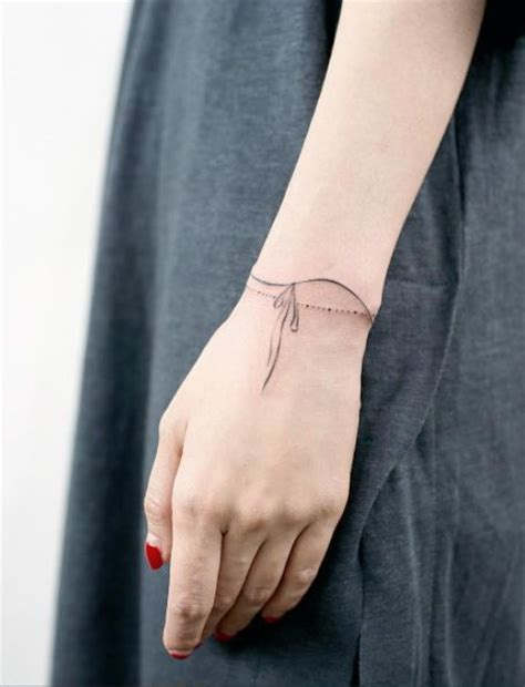 Best 25  Wrist bracelet tattoos ideas on Pinterest   Bracelet tattoos, Simple wrist tattoos and