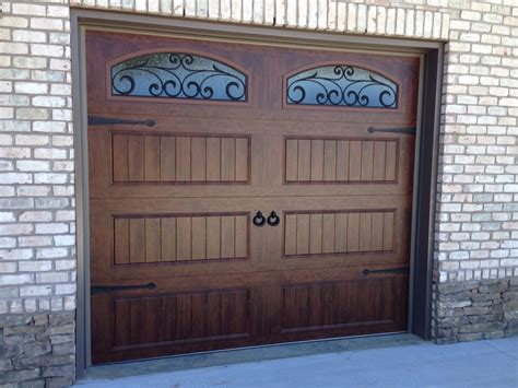 wrought iron garage doors clopay walnut finish gallery collection garage doors with